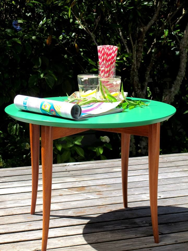 A simple pop of colour and an easy way of adding interest to a room.  A retro side table, wooden legs with Green top.