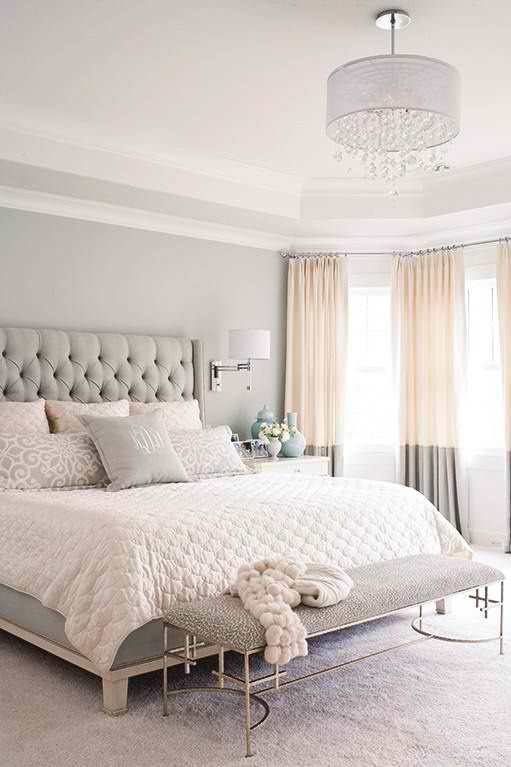 I like the two-tone drapes hung at the ceiling- this would probably work for our living room