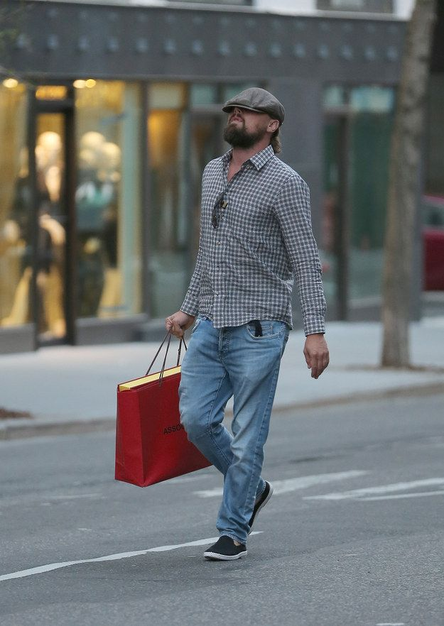 Because of this hat he's literally walking in the middle of the street. DANGEROUS MUCH?! | Leonardo DiCaprio's Hat Is A Danger To Everyone