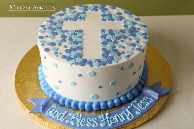 Sprinkled Cross #49Religious This cake is iced in white buttercream and sprinkled with colorful fondant circles. A cross is centered on the cake to add a religious theme.