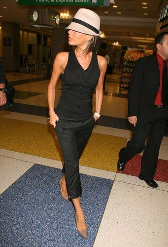 Love the black on black and neutral heels, which takes cropped city pants that usually make women look shorter and fatter and helps make the look long and lean. The nude shoes continue the illusion (black would have chopped her off at the ankles). The hat I could do without.