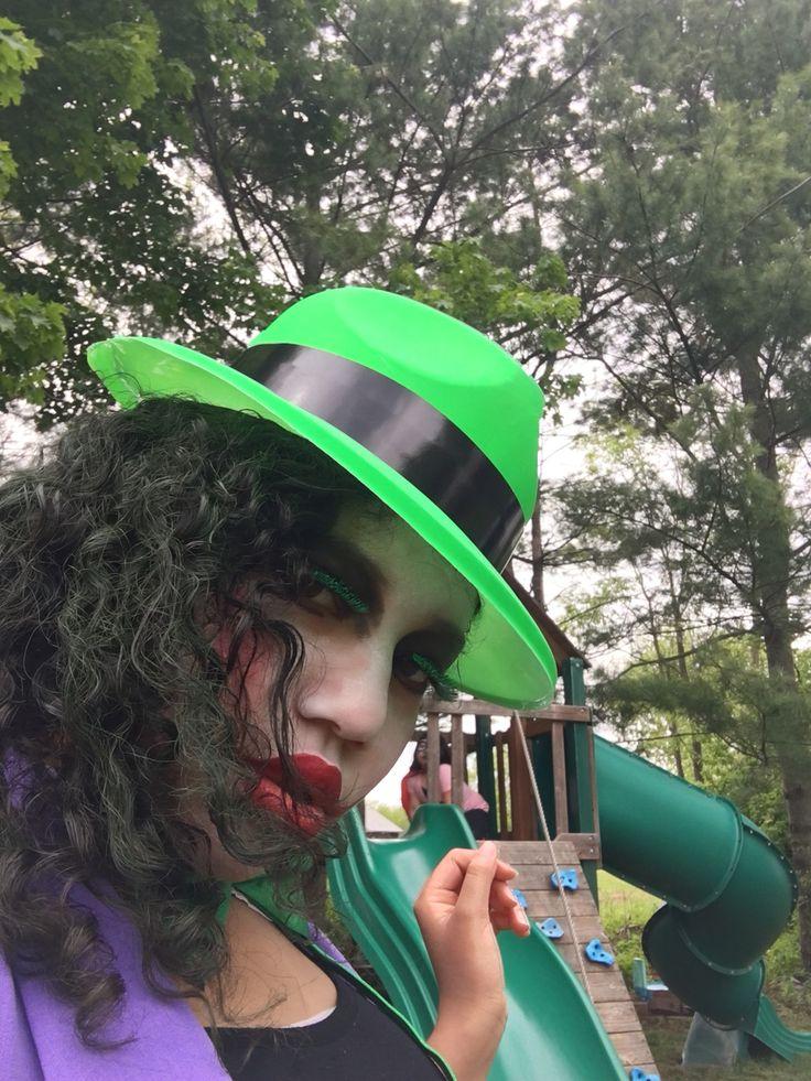 Homemade girl joker: Suspenders, tank top, tutu, stockings, hat, bow tie, green hair spray.