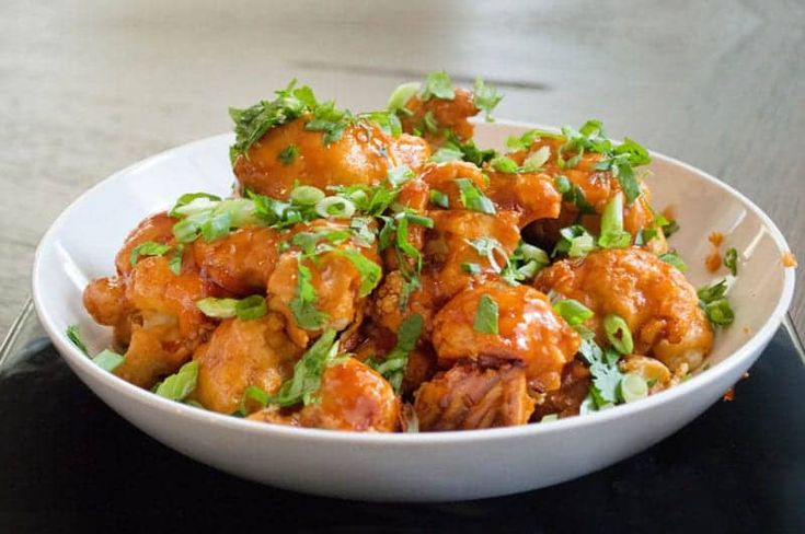 Baked Buffalo Cauliflower on Bachelor Recipe. Fantastically spicy and delicious bites as an appetiser perfect for your game day.