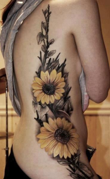 #sunflower tattoos flowers ribs