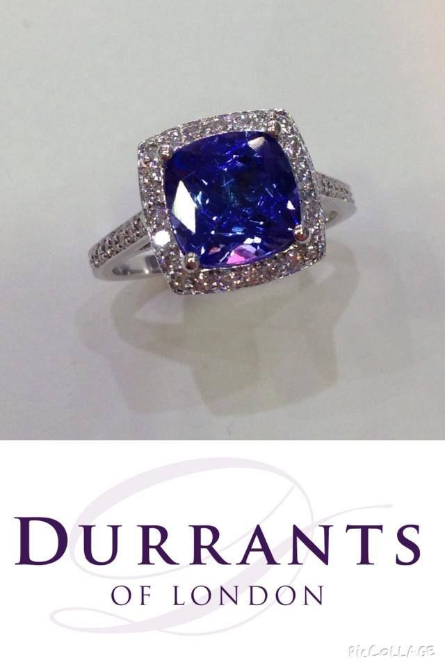 One 2.56ct cushion cut tanzanite set in a handmade 18ct white gold halo ring. Beauty.