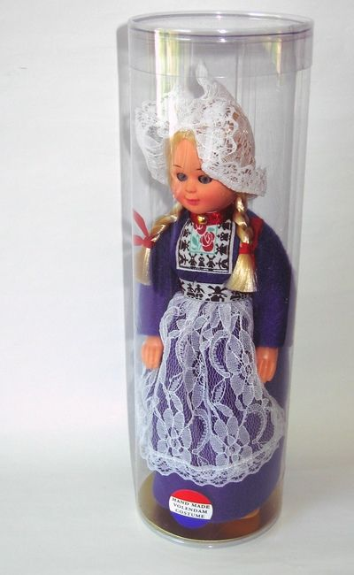 National costume dolls in plastic tubes