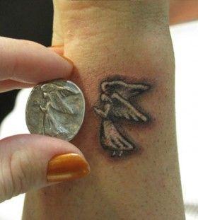 small angel tattoo mini foot hand and smallish tattoos pinterest small angel tattoo. Black Bedroom Furniture Sets. Home Design Ideas
