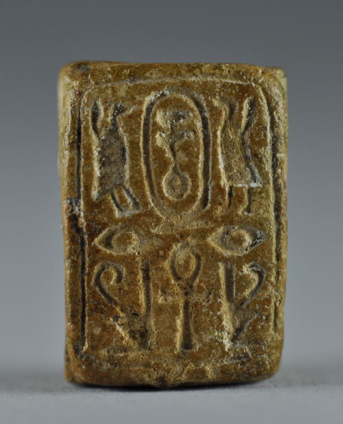 Egyptian seal, egyptian scarab seal, egyptian steatite plaque with six scarabs on back, Second Intermediate period, 1750-1570 B.C. Egyptian seal, egyptian scarab seal, egyptian steatite plaque, square base with a pseudo cartouche containing a Nefer sign flanked by symmetric sign and a central ankh, hold lengthwise for suspension, 2.2 cm x 1,5 cm. Private collection
