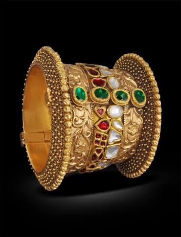 Gold cuff with uncut emeralds rubies and diamonds.Description by Pinner Mahua Roy Chowdhury