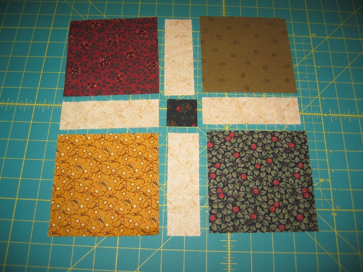 "Charm Square with Sashing Quilt. I didn't cut the 5"" squares.The sashing is cut 5""x 1 1/2"" for a 1"" finished sashing. The center square is cut 1 1/2"" x 1 1/2""."