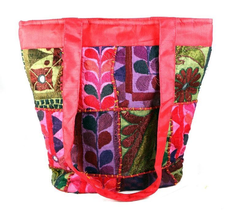 Silk patch work handicraft bag has a classic saddle bag shape, in patch worked diagonal swatches of corduroy, with long strap, media pocket, organizer pocket inside and concealed pocket.  #Buyhandbagsonline #HandmadeHandbags #Authenticdesignerhandbags #Womenswallets #Pursesonline #Handmadeitems #Styleincraft