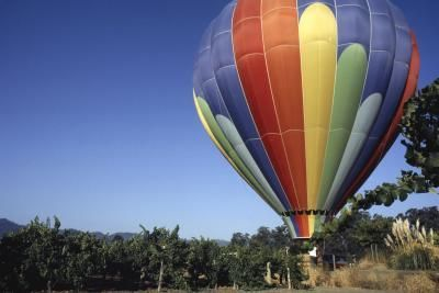 Take a romantic balloon ride over California's Napa Valley for an unforgettable vacation experience.