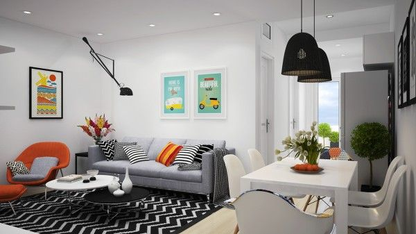 The main living area is not very large, but its open floorplan and coordinated color choices make each section of the space work well together. The living room takes hold of a mostly neutral palette, from a chevron striped area rug to a classic gray sofa. However, the contrast bursts of orange, by way of a throw pillow and arm chair is daringly bright and jovial.