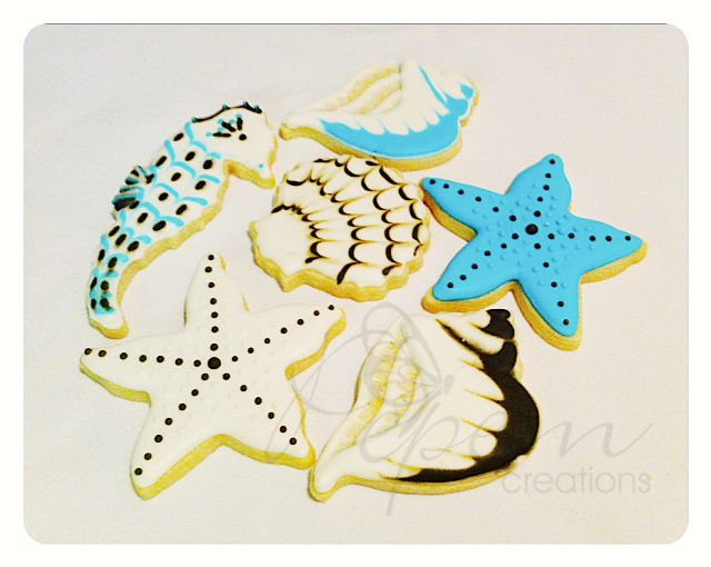 """Vanilla cookies with decorative almond icing and hand painted. Size 3"""" to 3 1/2"""""""