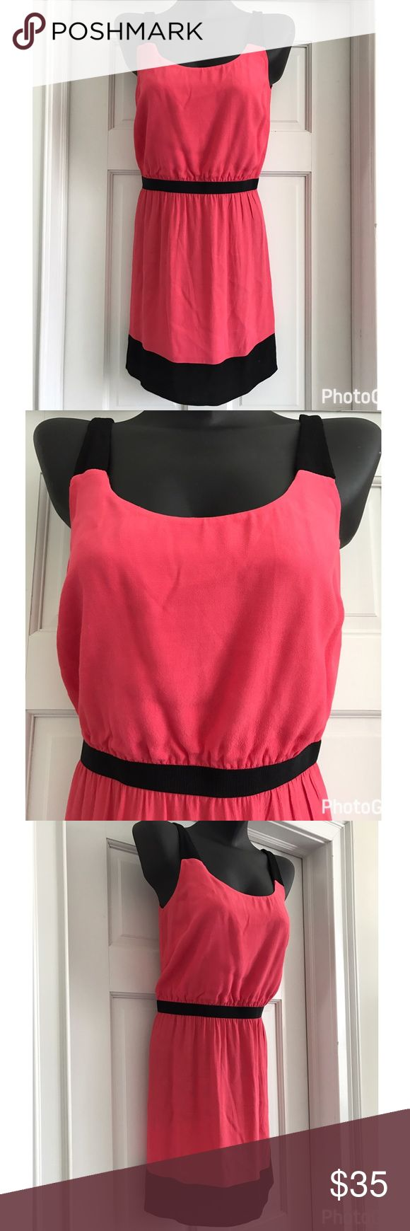 💜 LOFT Sleeveless Pink Sundress with Black Trim 8 LOFT sundress in a pink 100% Rayon fabric with black trim and black elastic waist.  Size 8.  Color is pink coral like very beautiful dress in very good condition. LOFT Dresses