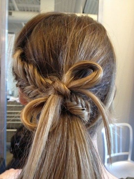 fishtail starting from one side down along the back of your head, and then wrap it underneath the remaining hairs. maybe she used the bottom part of her braid inorder to create the bow? :) you can tie a bow as you do with string but be sure to use pins to keep it in place!