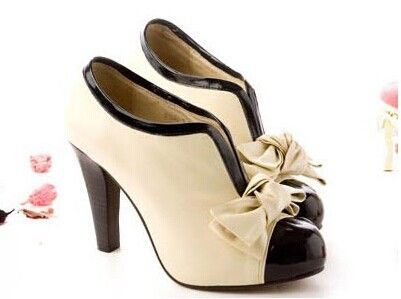 Vintage style beige and black bowknot booties high heel shoes. The first  option Penelope chooses when wearing a casual vintage style tea party dress.