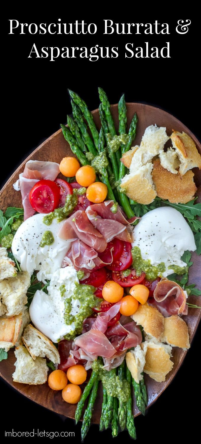 Prosciutto Burrata Asparagus Salad with tomatoes, melon, arugula, pesto and crusty bread. Makes a delicious salad or antipasto appetizer platter.