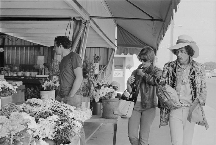 Jimi Hendrix at the Flower Stand, Monterey, CA, 1967  © ELAINE MAYES, 1967