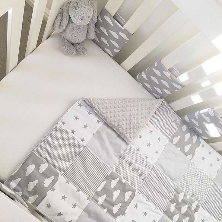 Our gorgeous grey clouds patchwork and cot bar bumpers. Matching blankets and storage baskets also available. Beautiful nursery bedding and decor.