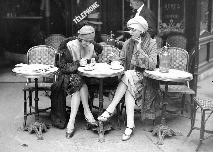 Two Paris women enjoying coffee at a sidewalk cafe in Paris, 1920s