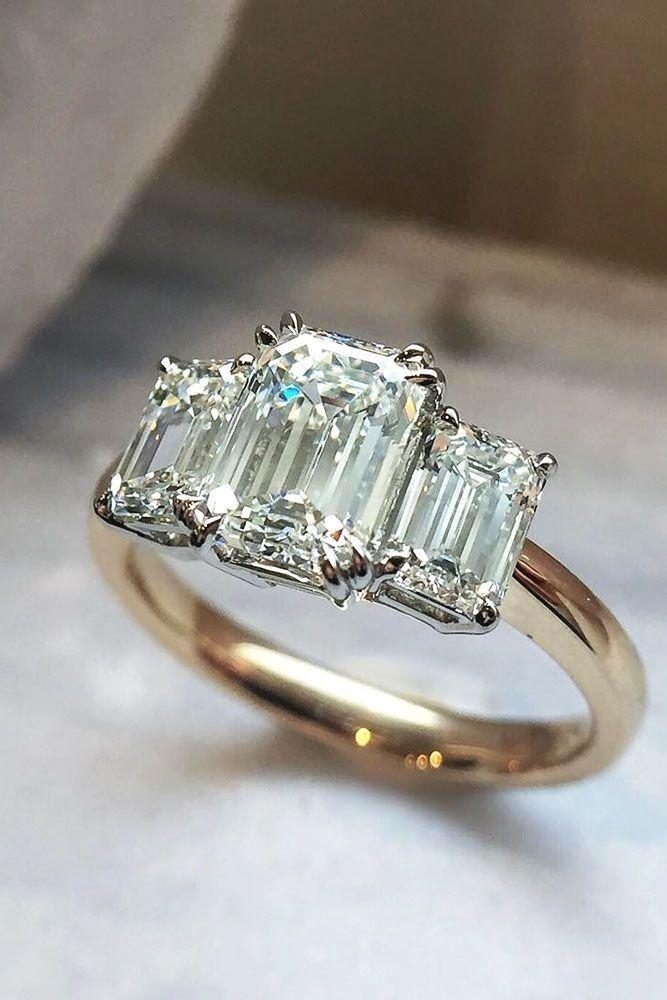 3 Stone Emerald Cut Diamond Ring With A Yellow Gold Band Diamonds