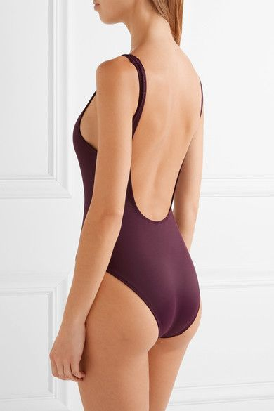 Burgundy stretch-polyamide Pulls on 80% polyamide, 20% elastane Hand wash Lotion, sunscreen, oil and chlorine can cause discoloration of this item; this is not a manufacturing defect. Please follow care instructions to keep your swimwear in the best condition