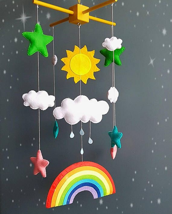 Rainbow baby mobile sun clouds mobile baby boy mobile handmade mobile baby girl mobile baby shower mobile nursery mobile When you purchase you can choose the color wooden mobile hanger (black,yellow,white,blue) Size -Wooden mobile hanger 10,6 inches (27 cm) -Rainbow 8.5 inches (21 cm) -big