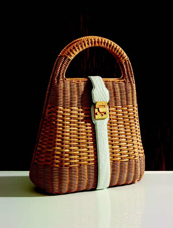 My mom had a few like this! One like a picnic basket & had flowers on the top...Every lady had a 'straw bag' for summer...