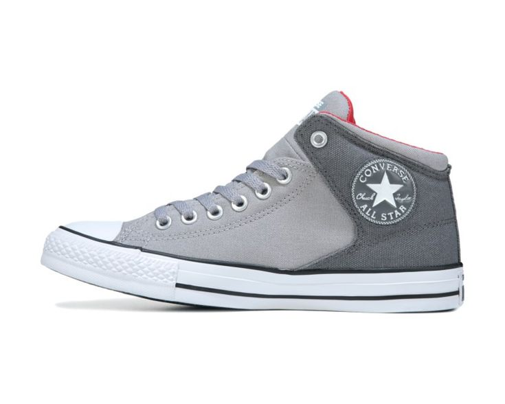 Get a new update to a classic look with the Chuck Taylor All Star High Street Mid Top Sneaker from Converse.Canvas upper in a casual sneaker styleLace-up frontEasy pull on entryContrast accentsVulcanized striped rubber midsole, toe capTraction outsole