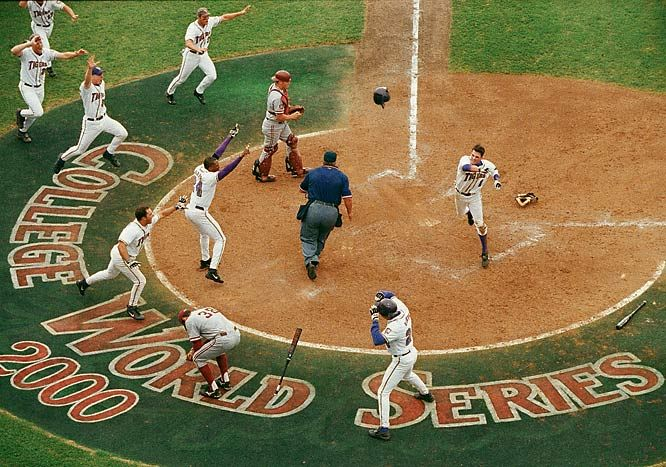 LSU shortstop Ryan Theriot tosses his helmet in celebration after scoring the game-winning run in the 2000 College World Series. LSU rallied from a three-run deficit to top the Stanford Cardinal 6-5 at Rosenblatt Stadium in Omaha, Neb.
