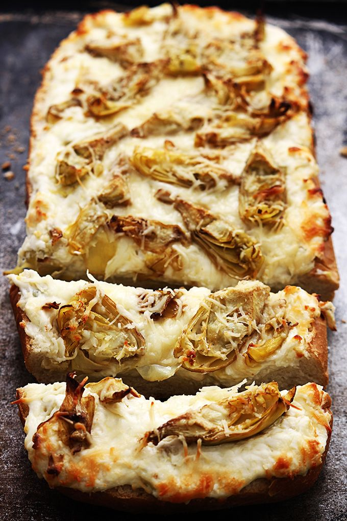 Salty roasted garlic and crispy artichoke bread  made with 3 kinds of cheese and baked til melty  This makes a great appetizer  or add grilled chicken for a hearty main dish