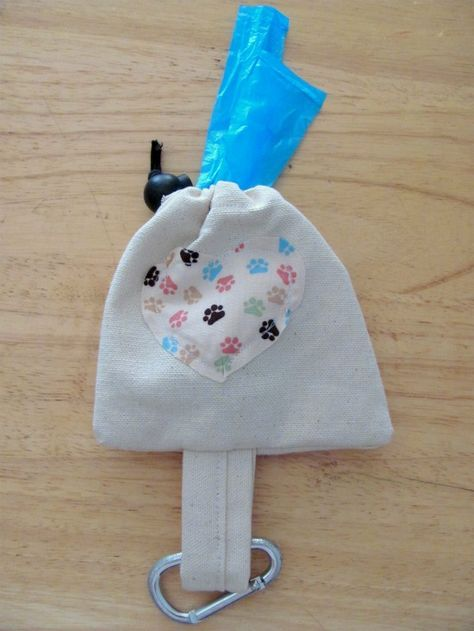 """This week, I have another simple sewing project for you. This tutorial will show you how to make a cute and handy little bag that you can attach to your dog's leash to hold plastic bags, your keys, treats, etc. What you will need: 10""""x 6"""" piece of fabric {I used a plain white[Read more]"""