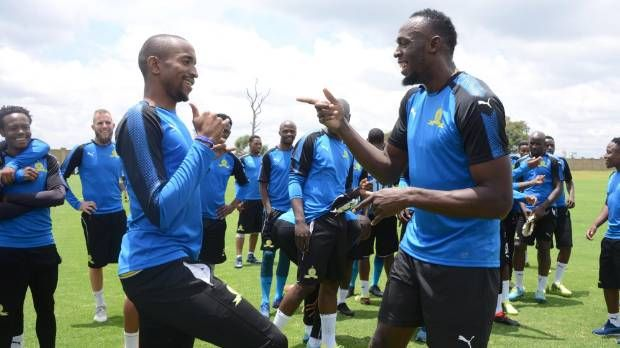 Former Olympics sprinter Usain Bolt signs his first professional football contract