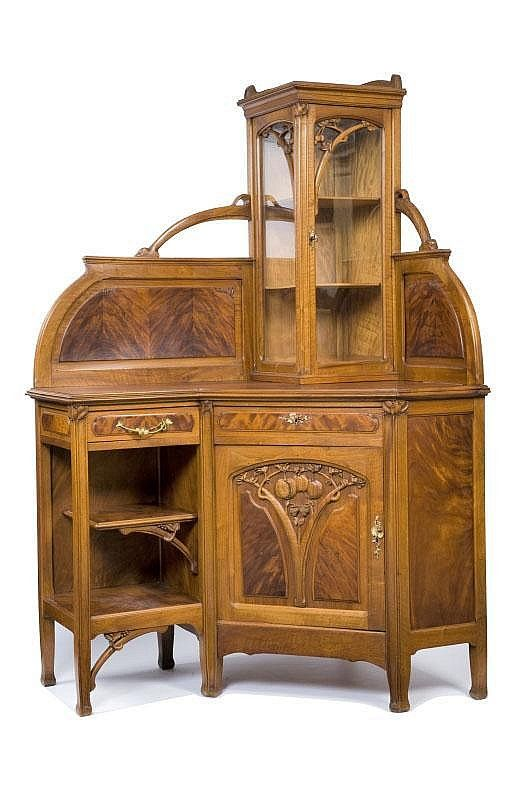 Léon Bénouville (1860-1903) (Attributed) - Corner Vitrine/Cabinet. Carved Mahogany and Glass with Gilt Bronze Hardware. France. Circa 1900. 200cm x 125cm x 92cm.