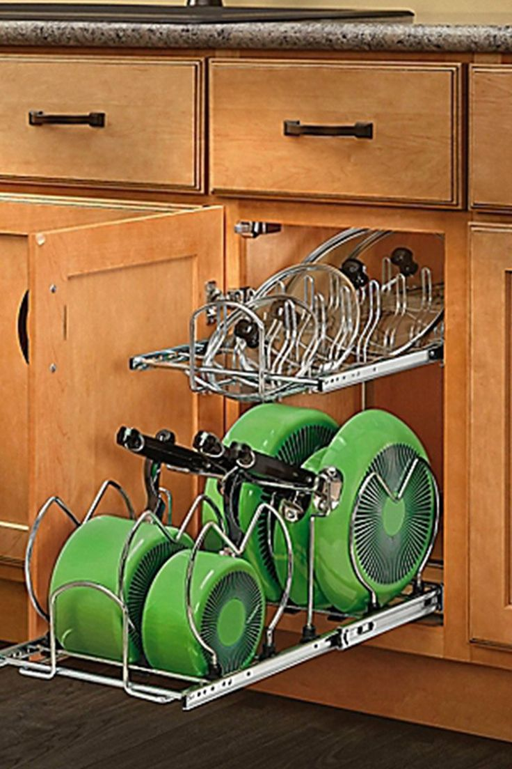 And bright kitchen update the little things apartment therapy - Cabinet Organization Is Hard To Come By But This Pull Out Pot Lid Organizer Is Perfect For It Whether It S Under The Sink Or In A Bottom Kitchen Cabinet