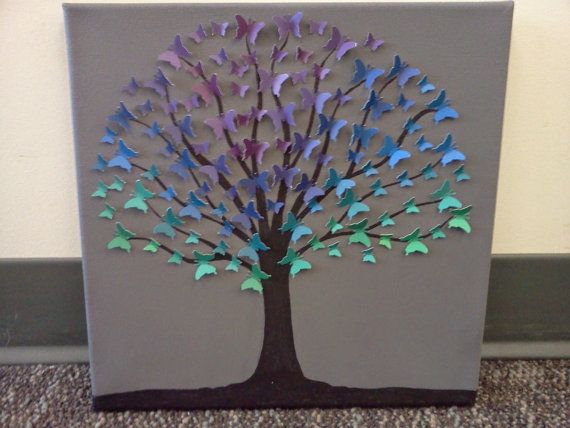 Unique upcycled butterfly tree wall art. Recycled paper tree gray background  purple, blue, teal, green butterflies made from paint swatches
