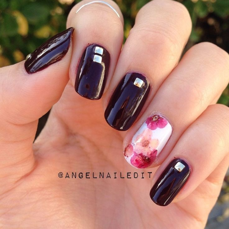 Studs and dried flowers nail art by Angel Son