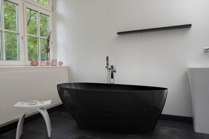 Modena Nero Bathtub | Decide now for a real stone cast bathtub at a discounted price.  Original stone cast designer bathtubs produced in Europe with a special discount; ... view details on www.treniq.com
