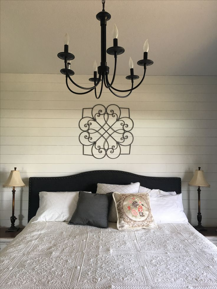 Master bedroom diy shiplap wall with metal artwork from HomeSense