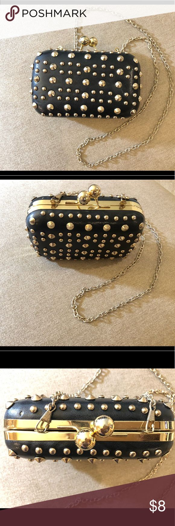 """Studded Gold and Black Clutch Small black leather clutch with gold studs. Perfect for a night out. Measures 6"""" by 4"""" and has a thin gold chain which can be removed. Has some minor signs of wear. MMS Design Studio Bags Clutches & Wristlets"""