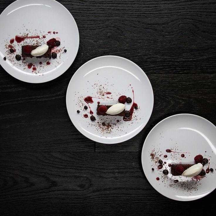 Chocolate fudge cake, raspberry and creme fraiche