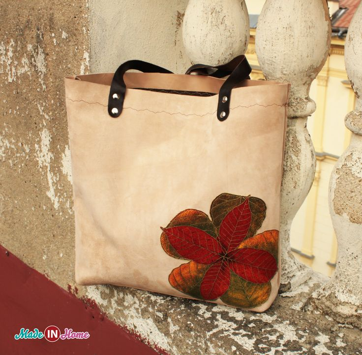 Simple yet stylish leather handbag in beige with dark brown straps. On the front is sewn sheet of cotton. Handbag magnet is switched on. Handbag is fully lined and there is a pocket for your small items.