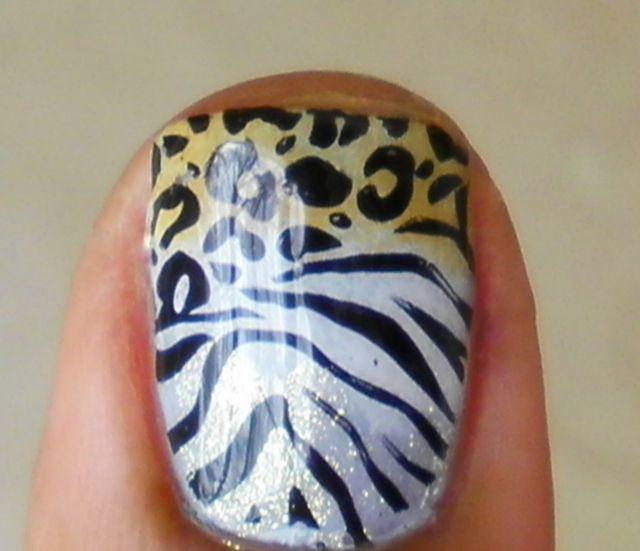 cheetah / leopard and zebra glitter yellow / brown and black and white animal print nail polish cute cute cute cute cute. Very jersey girl