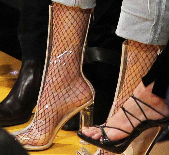 Kendall wore fishnet stockings inside her Yeezy PVC ankle boot