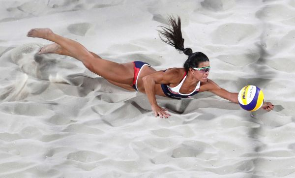 Costa Rica's Nathalia Alfaro dives for a ball during a women's beach volleyball match against Netherlands at the 2016 Summer Olympics in Rio de Janeiro, Brazil, Monday, Aug. 8, 2016.