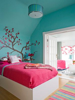 Love this bold girl's bedroom!  I love the way it opens into a white sitting room, too.  Brightens the whole look.  This room, done in daring strokes of aqua and pink, is proof that two colors can pack a punch. Looking to create your own dramatic look? Use large blocks of your chosen colors (such as on the wall and bedspread), limit patterns, and add in doses of white for a crisp finish.