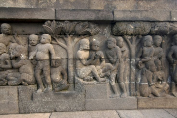 Close-up look at relief at a wall in Borobudur temple in Java, Indonesia