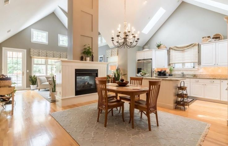 **LOVE open concept, fireplace, + high pitched ceilings