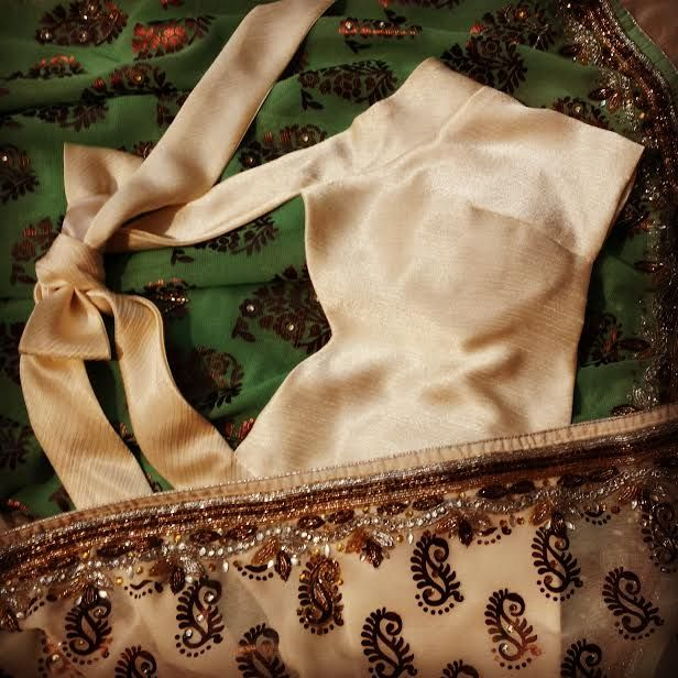 Off white halter neck Blouse with charming accessory at the back SKU: SDA $65.00 $55.00 Off white halter neck Blouse with charming accessory at the back The blouse is lightly padded and the off white fabric is linned with the softest satin.  Please ask for more pictures and details by clicking here or emailing shamadesigns@gmail.com